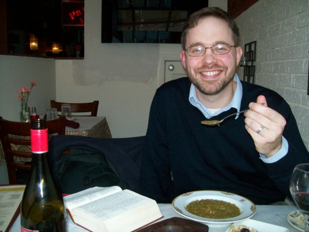 University of Chicago biblical scholar Jeffrey Stackert tries out a bowl of lentil soup. (Photo by Nina Barrett)