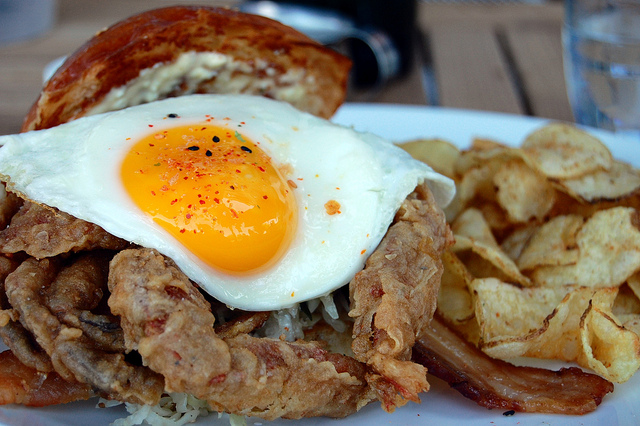 The reigning Royale breakfast sandwich at Lula Cafe: buttermilk-fried soft-shell crab, sunny side up farm egg, bacon, coleslaw, pickled ramp gribiche, on a soft buttered bun (WBEZ/Louisa Chu)