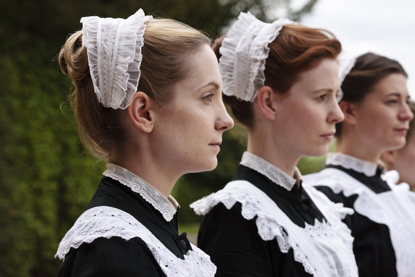 The maids of 'Downton Abbey.' The memoir of real life kitchen maid Margaret Powell served as one inspiration for the show.  (AP/PBS, Carnival Film & Television/Nick Briggs)