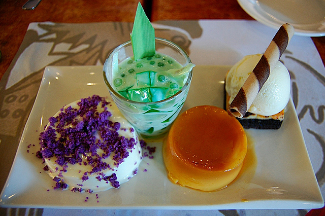 Dessert sampler with buko pandan, cream cheese brownie à la mode, leche flan, and Ube Creme Decadence at Max's Restaurant in Manila, Philippines (WBEZ/Louisa Chu)