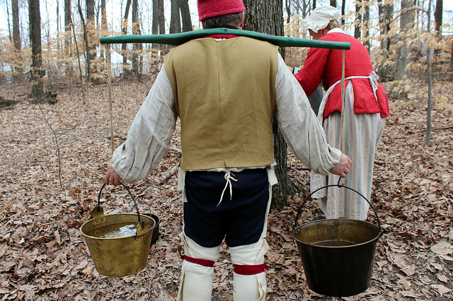 French camp settlers with maple sap buckets at National Maple Syrup Festival on Burton's Maplewood Farm in Medora, Indiana (WBEZ/Louisa Chu)