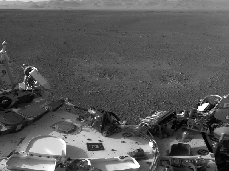 his mosaic image shows part of the left side of NASA's Curiosity rover and two blast marks from the descent stage's rocket engines. (Photo by NASA/JPL-Caltech)