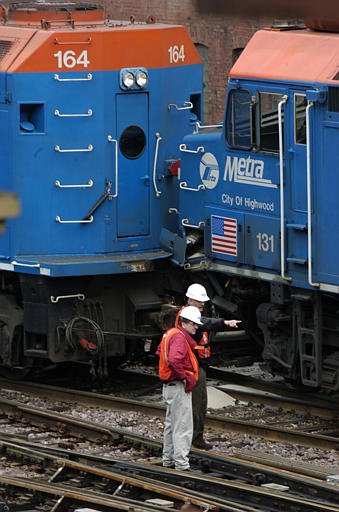 Metra officials investigate a commuter train accident in 2004 in Chicago. (AP Photo/Jeff Roberson)