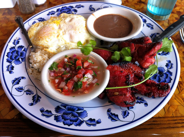 Filipino breakfast with tocino and longaniza, plus a side of champorado, at Uncle Mike's Place in Chicago (WBEZ/Louisa Chu)