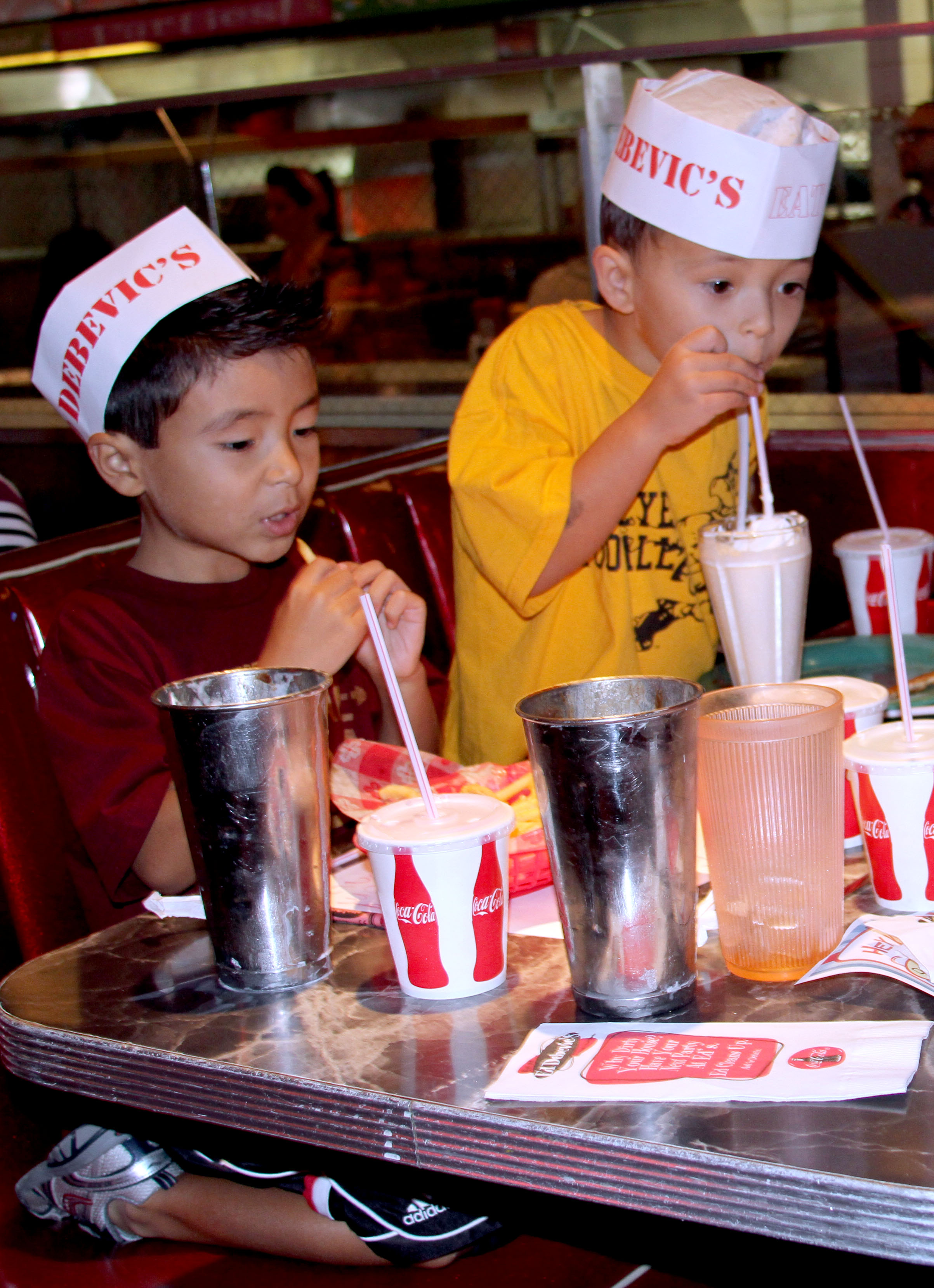 Gavin (6) and Grayson (4) Anderson enjoy free milkshakes at Ed Debevic's in River North on Wednesday afternoon. The restaurant offered CPS students free milkshakes during the strike. (Tricia Bobeda/WBEZ)