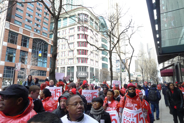 Protesters stopped outside a Nike store on Michigan Avenue. They're calling for downtown workers to make a 5 minimum. (WBEZ/Lewis Wallace)