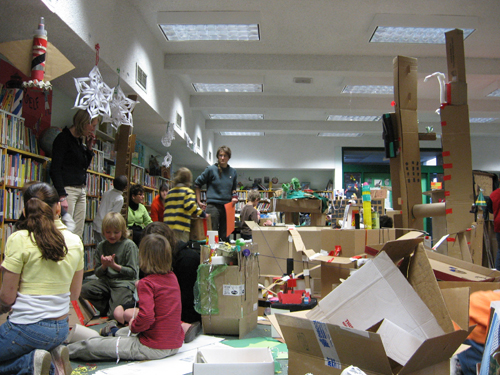 New Your City, Ian Cozzens' collaboratively built cardboard city, in the Fox Point branch of the Providence Public Library in 2007. Cozzens, center, helped kids channel their inner urban planner. (Courtesy of Ian Cozzens and Ann Schattle)