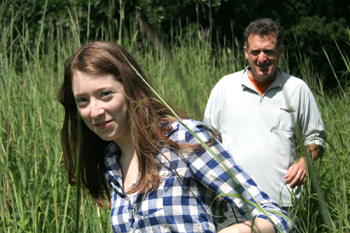 Libby Morris, front, and her dad Doug Morris follow a trail through the Somme Prairie Nature Preserve in search of wild onions. Doug Morris sparked Curious City's investigation by asking the question: Does the wild onion for which Chicago was named still grow in the region? (WBEZ/Chelsi Moy)