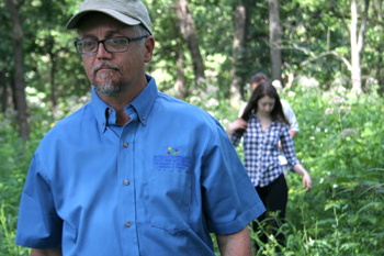 Doug Taron with the Peggy Notebaert Nature Museum leads a hunt for wild onions through a forest preserve in Northbrook. Chicago is named after a wild onion. Although, no one can say for sure which  species of onion it is. (WBEZ/Chelsi Moy)