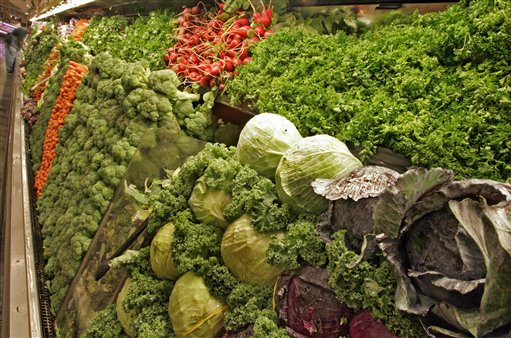 Cabbages, salad greens, radishes and broccoli are among the selection of organic produce on sale at a Whole Foods Market. (AP Photo/Richard Drew)