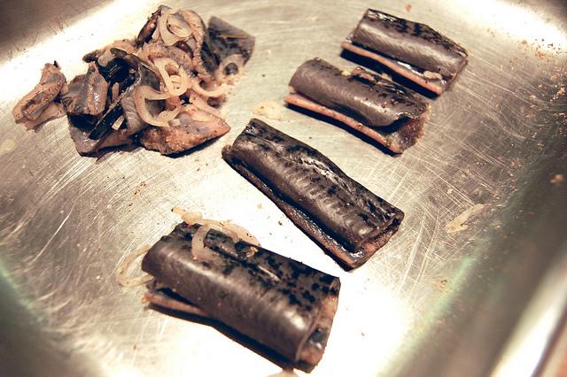 Seasoned lamprey with shallots at Pleasant House Bakery (WBEZ/Louisa Chu)