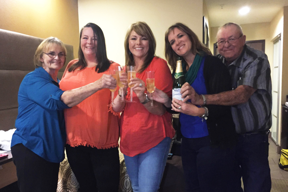 Dana Bowerman's family and best friend joined her to celebrate her release with sparkling grape juice Monday: Pictured from left: Bowerman's mother, Rose West, Bowerman, sister Paula Bailey, friend Michelle Elliott, stepfather Dwayne West. (Syeda Hasan /NPR)