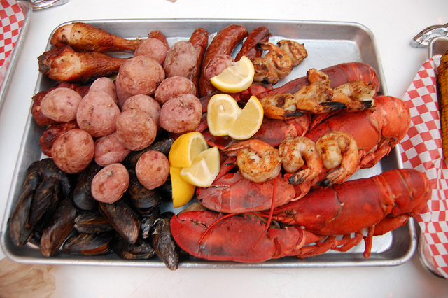 Grilled Maine lobster and Old Bay BBQ shrimp; smoked mussels, clams, buttermilk-brined chicken, Mikeska sausage and summer salt new potatoes. (WBEZ/Louisa Chu)