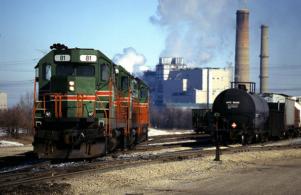 Trains sit at the south end of the yard in Powerton, Ill., near the power plant. Powerton's coal plant was the second biggest greenhouse gas emitter in Illinois, according to EPA data. (Flickr/Nick Suydam)