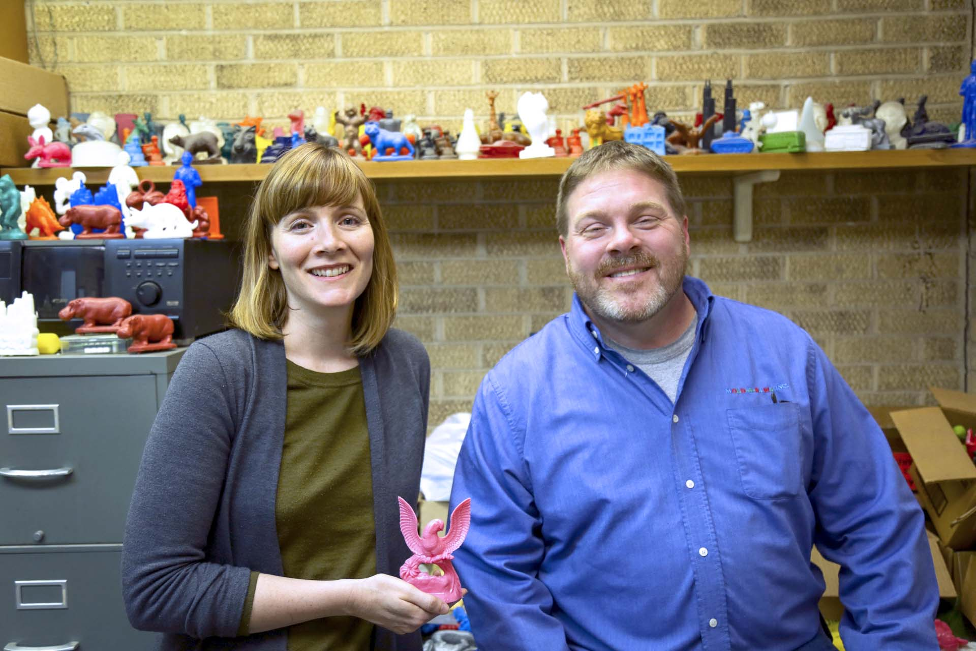 Questioner Julie Piacentine and Mold-A-Rama Inc. co-owner Paul Jones at the businesses' headquarters in Brookfield, Illinois. (John Fecile/WBEZ)