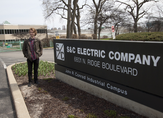 Question-asker Matthew Byrd outside of the S&C Electric Company, where his grandfather worked.  (WBEZ/Jesse Dukes)