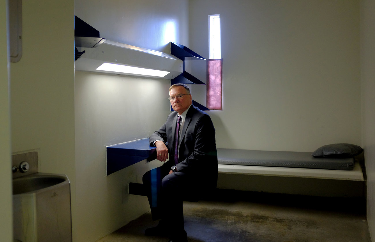 Rick Raemisch, the director of Colorado's Department of Corrections, poses for a portrait in a solitary confinement cell similar to the one he stayed in during a tour of the Colorado State Penitentiary in 2014. (Matthew Staver/Landov)
