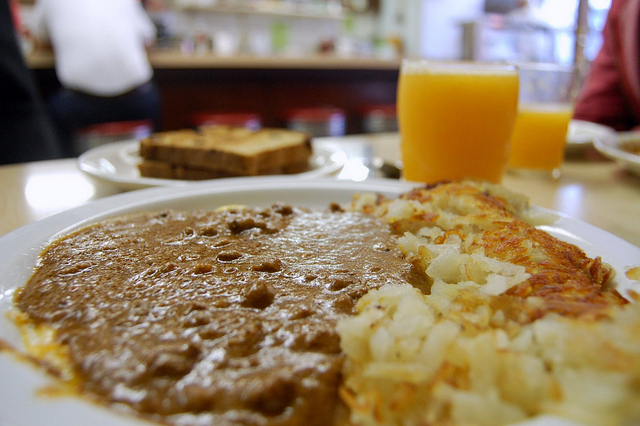 Chili on eggs, hash brown potatoes, double toast, and fresh-squeezed orange juice at Ramova Grill, 1929-2012 (WBEZ/Louisa Chu)