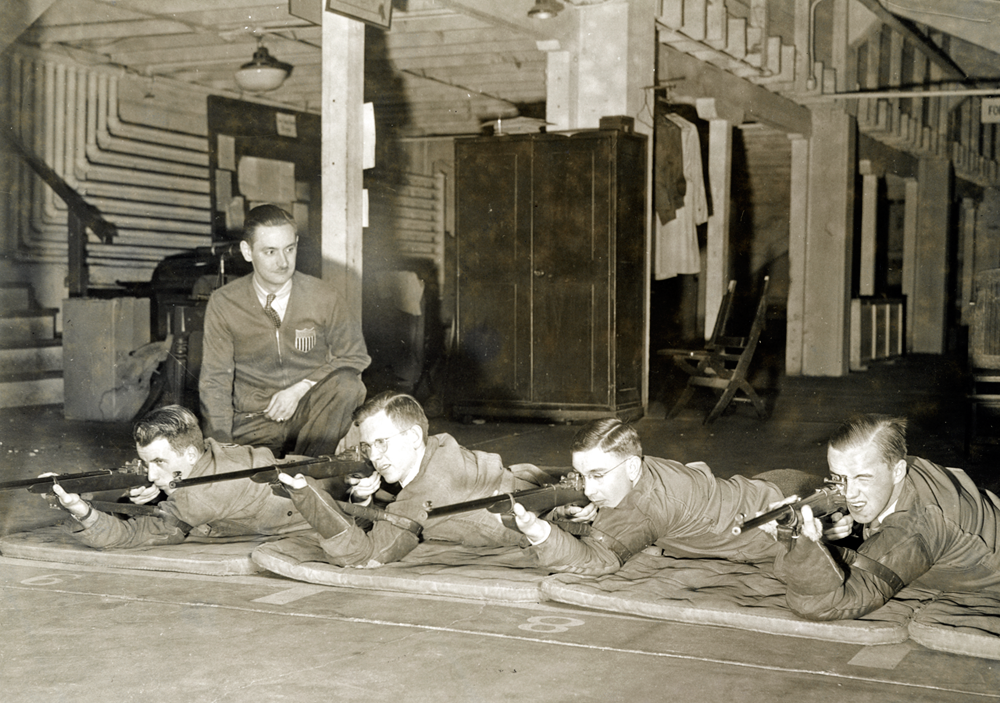 Students in the advanced rifle marksmanship class at the University of Chicago practice shooting in the university's West Stand range. Students in the advanced class, sponsored by the Institute of Military Studies at the time, regularly passed tests for the highest Army small-bore ranking. (Photo courtesy University of Chicago Photographic Archive, [apf4-00833], Special Collections Research Center, University of Chicago Library.)