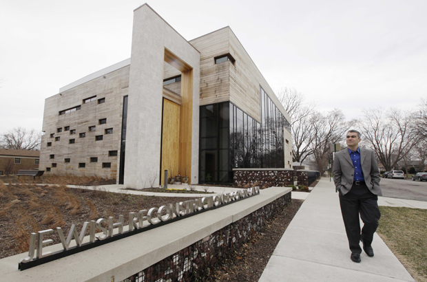 Rabbi Brant Rosen walks past the Jewish Reconstructionist Congregation synagogue in Evanston, Ill. Dr. Rachel Adler argues that Reconstructionist Judaism has proved a compelling contemporary theology for some American Jews. (AP/M. Spencer Green)