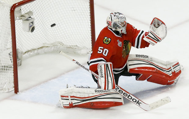 Corey Crawford couldn't make the save in overtime. (AP/File)