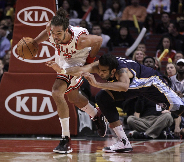 Joakim Noah and the Bulls won't roll over this season. (AP Photo/Charles Rex Arbogast)
