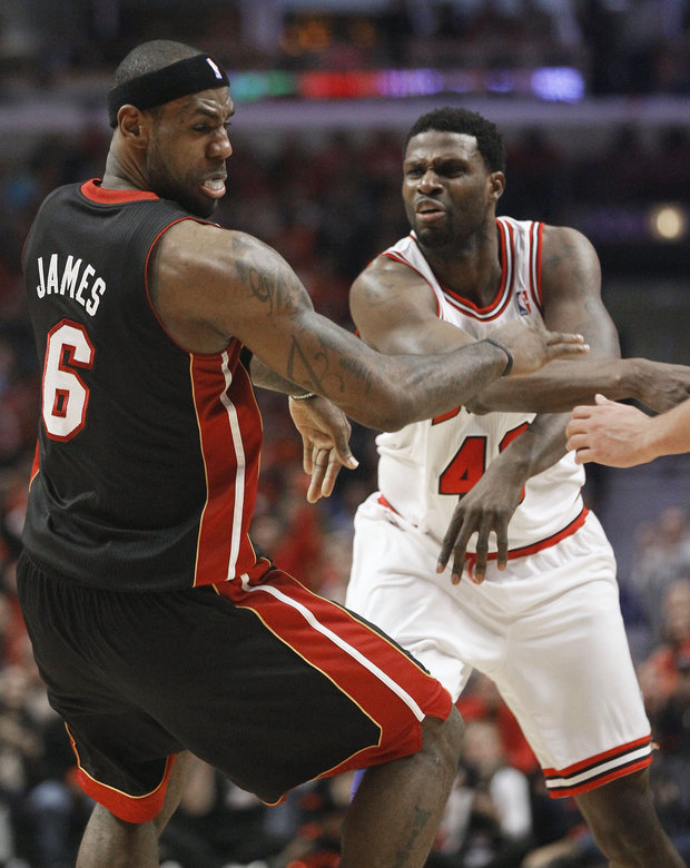 Physical play has been big in the Bulls-Heat series. (AP Photo/Charles Rex Arbogast)