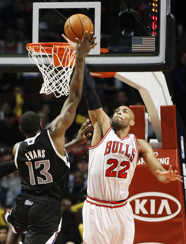 Taj Gibson got a win and a new contract Opening Night. (AP/Charles Rex Arbogast)