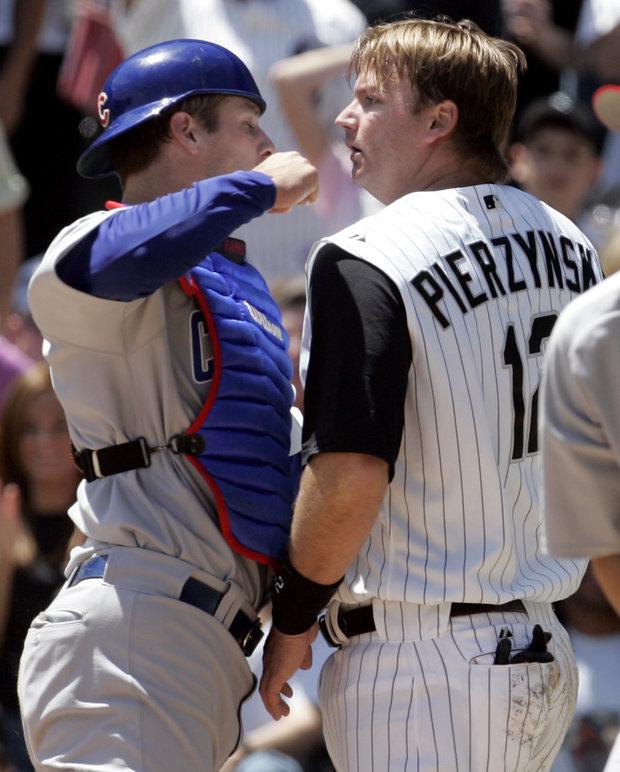 May 20, 2006 Cubs-Sox game: Cubs catcher Michael Barrett punches Sox catcher A.J. Pierzynski. (AP File)