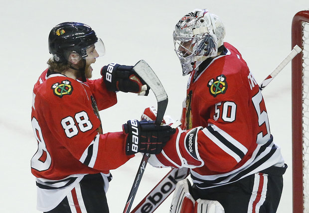 Ptrick Kane and Corey Crawford have paved the way for  Blackhawks championship. (AP Photo/Charles Rex Arbogast)