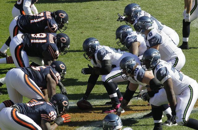 The Chicago Bears and Seattle Seahawks Oct. 17, 2010. (AP Photo/Charles Rex Arbogast)