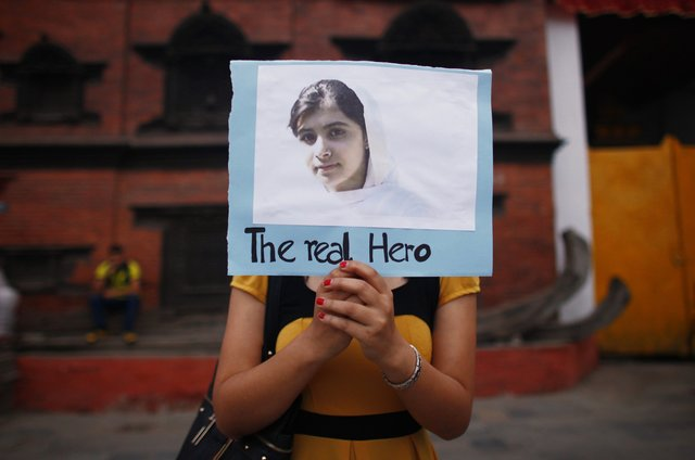 Nepalese student holds picture of Malala Yousafzai at candlelight vigil (AP Photo/Niranjan Shrestha)