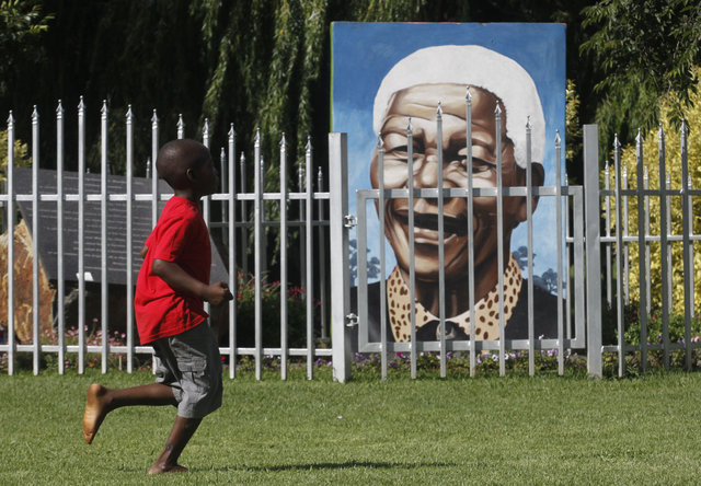 Nelson Mandela is more than a leader, he is a symbol of freedom and unity (AP Photo/Denis Farrell)