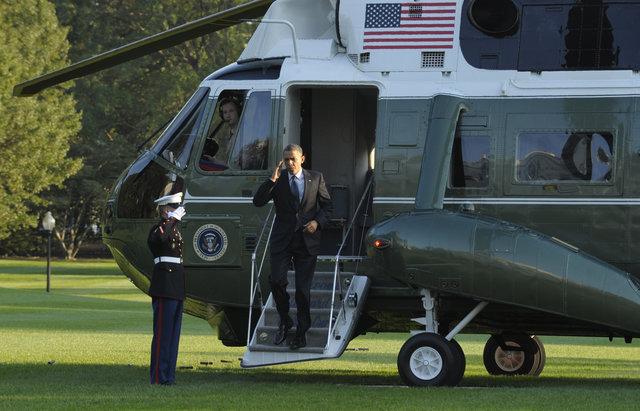 President Barack Obama exiting the Marine One (AP Photo/Susan Walsh)