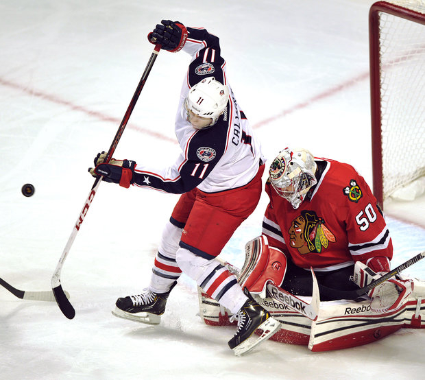Corey Crawford and the Blackhawks continue to be winners. (AP Photo/Jim Prisching)