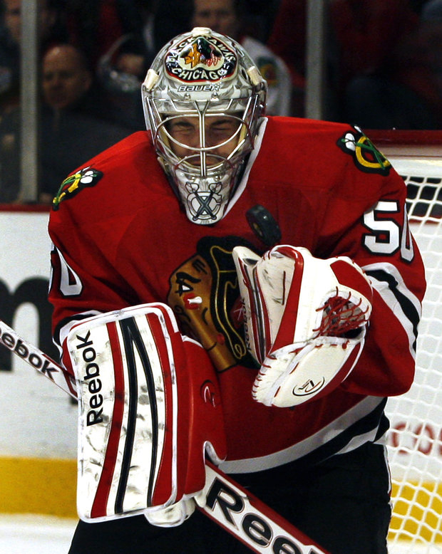 Corey Crawford stopped 25 shots posting a shut-out.(AP Photo/John Smierciak)