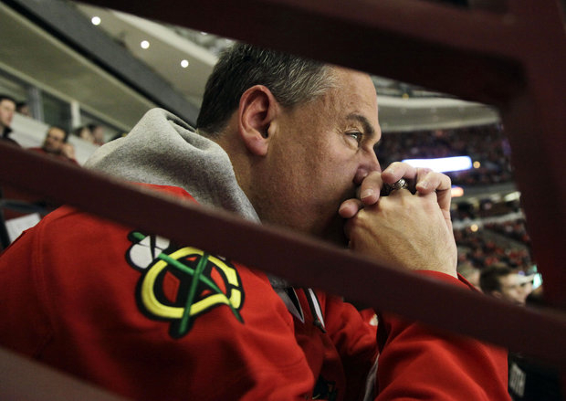 First time Hawks fans watch their team lose at UC. (AP Photo/Nam Y. Huh)