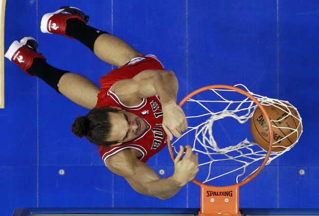 Joakim Noah has been playing at a higher level this year. (AP Photo/Matt Slocum)