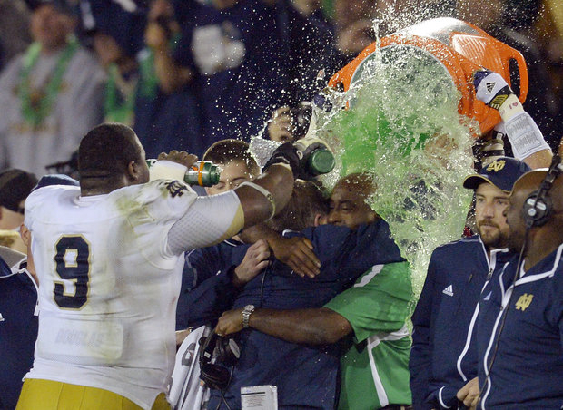 Irish Coach Brian Kelly gets a shower after cliniching a trip to the Championship game.(AP Photo/Mark J. Terrill)