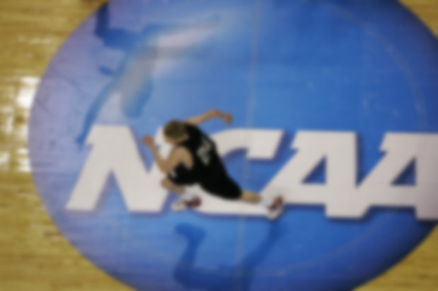 NCAA men's basketball has everyone talking brackets and pools. (AP Photo/David Duprey)