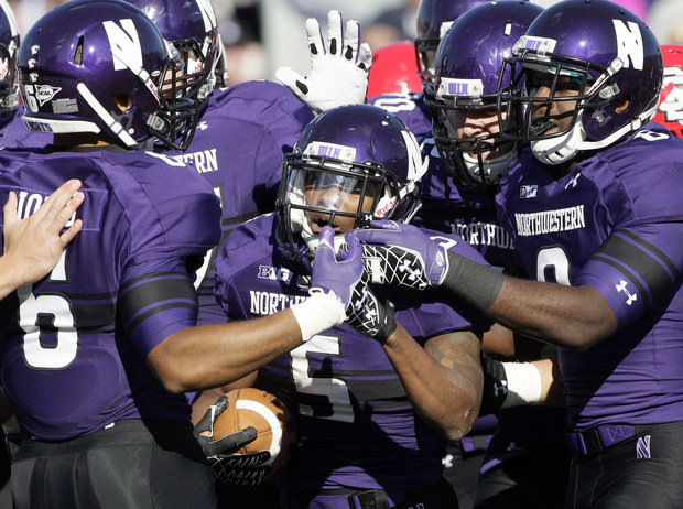 Northwestern waits for their Bowl game destination. (AP Photo/Nam Y. Huh)