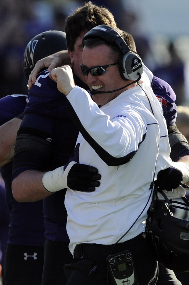 NU coach Pat Fitzgerald finally wins a bowl game. (AP Photo/Stephen Morton)