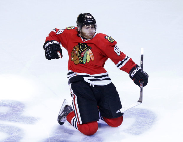 Patrick Kane's hat trick is part of the fun of the Blackhawks. (AP Photo/Charles Rex Arbogast)