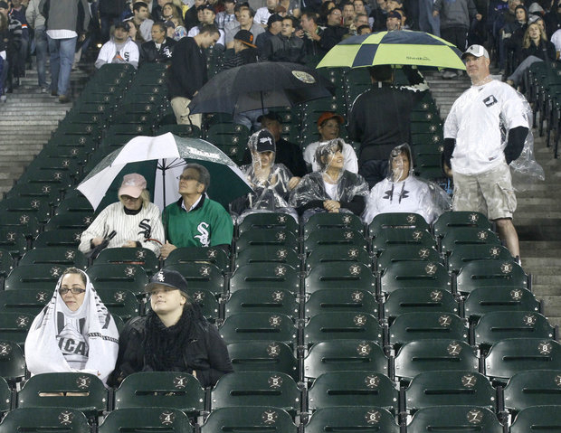 Some loyal Sox fans gave support no matter the outcome. (AP Photo/Charles Rex Arbogast)