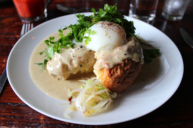 Bang Bang biscuits and fennel gravy with country fried pork, farm egg, pickled fennel, and herb salad (WBEZ/Louisa Chu)