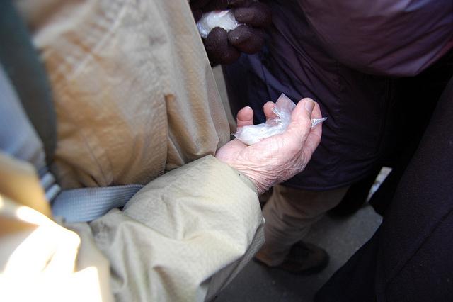Lucky mochi caught by elderly man at Zojoji temple in Tokyo, Japan on Sestsubun (WBEZ/Louisa Chu)