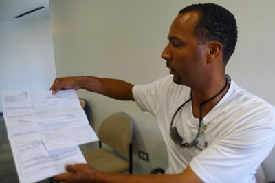 Louis Wilkins, a former inmate at Vandalia, looks over a grievance he filed about conditions there. (WBEZ/Rob Wildeboer)