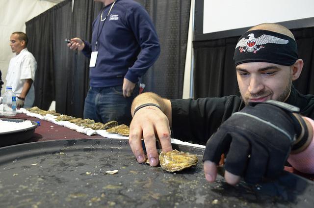 Erik Vollano of BOKA preps oyster mise en place at Supreme Shucker 2012 finals (WBEZ/Louisa Chu)