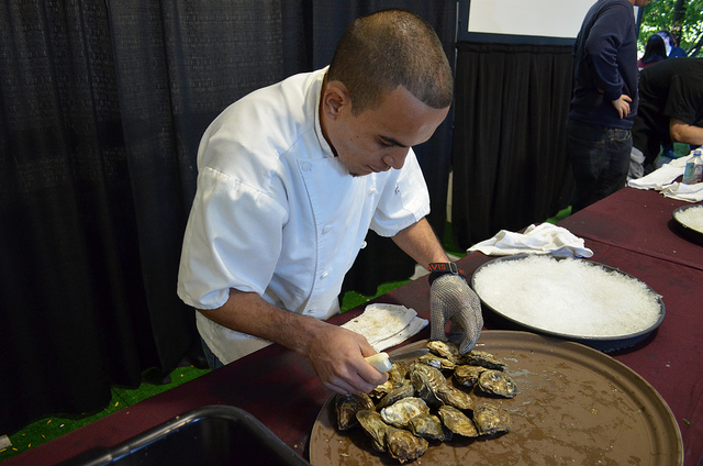 Luis Pedroza of Benny's Chop House preps oyster mise en place at Supreme Shucker 2012 finals (WBEZ/Louisa Chu)