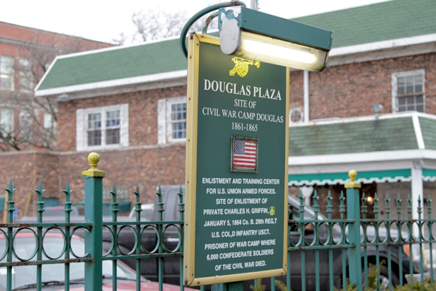 The first official acknowledgment of Camp Douglas was erected in the fall of 2014 outside of Ernie Griffin's former funeral home at 32nd Street and Martin Luther King Drive in Chicago's Bronzeville neighborhood. (WBEZ/Logan Jaffe)